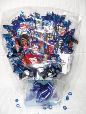 Candy bouquet in box wrapped in bubble wrap